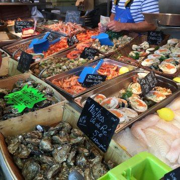 Shellfish-monger at La Flotte market